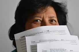 taxes, woman holding tax forms